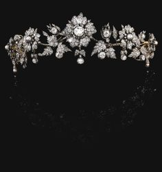 PROPERTY OF AN ITALIAN PRINCELY FAMILY Natural pearl and diamond tiara, late 19th century Designed as graduated foliate sprays suspending diamond and natural pearl drops, set with cushion-shaped, circular-, single- and rose diamonds and natural pearls.
