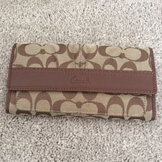 Coach wallet I'm good condition coach wallet! Has some wear on the back Coach Bags Wallets