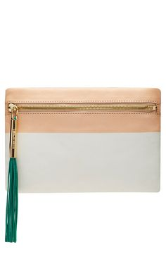 A bright contrast tassel and gold hardware lends a modern touch to this sophisticated clutch shaped from smooth leather .
