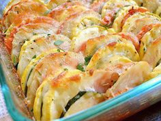 Vegetable Tian (thinly sliced veggies topped with cheese and then roasted)...  Ingredients:  1 Tbsp. olive oil 1 medium yellow onion 1 tsp. minced garlic 1 medium zucchini 1 medium yellow squash 1 medium potato 1 medium tomato 1 tsp. dried thyme to taste salt & pepper 1 cup shredded Italian cheese