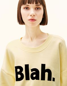 Oversized sweater with slogan. Discover this and many more items in Bershka with new products every week
