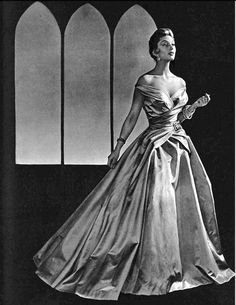 1954 Marie-Hélène in gala evening gown of silk-satin with crossed draped bodice and very full skirt, by Jean Patou, photo by Pottier
