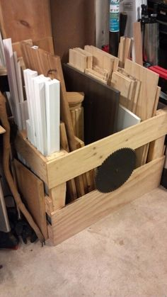 Pallet cut in half, scrap plywood nailed to the ends to create a small shop lumber storage box. Small trim and small lumber can stand in the side slots.