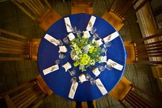 Beautiful blue linens and yellow floral arrangements seen during a wedding reception in our dining room.
