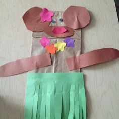 Luau or Beach Party - hula monkey puppet craft - paper bags, green tissue paper for skirt, paper or foam shapes, wiggly eyes