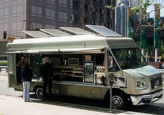 Green truck on the go. Solar Food Truck