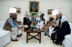 Reagan meeting with the Mujahideen. Al-Qaeda was born out of the resistance to the Soviet invasion of Afghanistan and received, directly and indirectly, many weapons from the US.