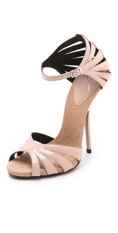 Giuseppe Zanotti Alien Patent Sandals.. These are gorgeous but i would die if i tried to walk in them.