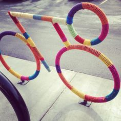 Knitted bike rack graffiti.