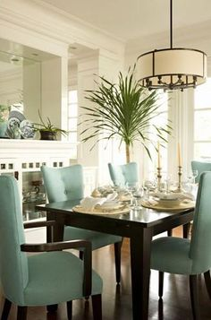Drum light, wood table and upholstered dining chairs