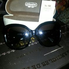 Coach sun glasses Black sunglasses with silver coach logo and white & grey on side. Used a few times in very good condition. Comes with Box and coach insert. Coach Other