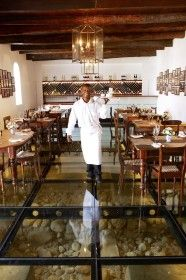 When dining at Solms-Delta, you not only walk into history at the new restaurant on the 319-year-old Solms wine farm, you walk over it.    Fyndraai is built into the site of the farm's original wine cellar, and upon entering you step onto a glass floor exposing the original foundations, uncovered during extensive archaeological diggings.