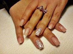 Love this nude nail with bling.