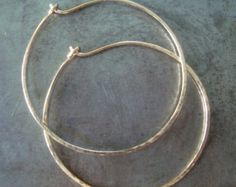 These are the real thing!! Earrings to last a lifetime!! Sturdy construction yet light as feathers!! These hoops are made of solid 12ga 14kt Gold Filled wire. Formed, annealed, hammered, and polished by me. Each hoop measures 5/8 inches wide and 1 5/8 inches tall. Should you prefer rose gold filled, just send a conversation indicating rose gold filled.  Also available in solid 14kt yellow gold and sterling silver. Send me a conversation for details.  The earrings are shipped ready for gift…