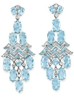 A PAIR OF ART DECO AQUAMARINE AND DIAMOND EAR PENDANTS, BY CARTIER  Each of chandelier design, suspending a fringe of hexagonal-cut aquamarines, from the rectangular-cut aquamarine and single-cut diamond openwork plaque, to the old European-cut diamond and oval-cut aquamarine surmount, mounted in platinum, circa 1930 Signed Cartier, London, no. 9183