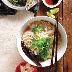 In this vegetarian pho recipe, individual bowls of fragrant vegetable broth and rice noodles are easily customized to suit both kid and adult tastes. Beauty!