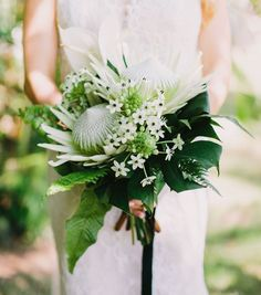 STUNNING Bridal Bouquet Showcasing: Green/White King Protea, Star Of Bethlehem, Green Monstera, Green Maiden Hair Fern, Green Leather Leaf Fern + Additional Tropical Green Foliage ••••