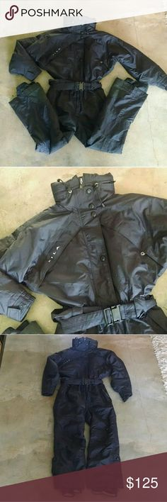 """Fila Sno-Tec Black Coverall Snowsuit No offers Fantastic black Fila sno-tec snow suit jumpsuit -great details - cozy warm performance suit Tag size 10 estimated fit s-m shown on 5'8"""" size 4 32d-25-35 for ref.  approx meas: armpit 21.5""""  waist 13.5-14.5""""  hip 21"""" total length 55.5"""" small tear on leg (shown) overall good condition tags ski winter snowboard onesie sport sportswear puffer coat flight suit coveralls overalls Fila Pants Jumpsuits & Rompers"""