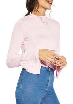 ruffle neck trumpet top by Topshop. Short pie-crust ruffles trace the neck while flared cuffs make every motion more dramatic in this light and stretchy ...