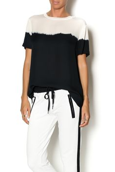 This silk tee by Vince features a crew neckline with ribbed trim, short sleeves and color blocked dip dye. Wear this seasons dip dye trend with white silky pants and black lace up sandals.    Dip Dye Silk Tee by Vince. Clothing - Tops - Short Sleeve Clothing - Tops - Blouses & Shirts Greenville, South Carolina