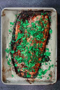 Easy Baked Salmon with Garlic-Balsamic Glaze | The Mediterranean Dish. This all-star easy baked salmon recipe delivers on both presentation and flavor! The garlic-balsamic glaze does all the work in flavoring, and don't skip the fresh herbs. Great for a quick weeknight meal or a special dinner. Recipe from TheMediterraneanDish.com