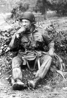 """US soldier packing a """"Grease gun"""", Normandy 1944"""