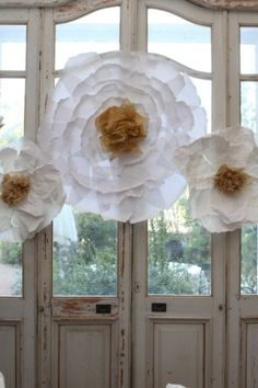 paper flower decoration - another great idea to use with these paper flowers, is to add string and hang them as a chandelier piece