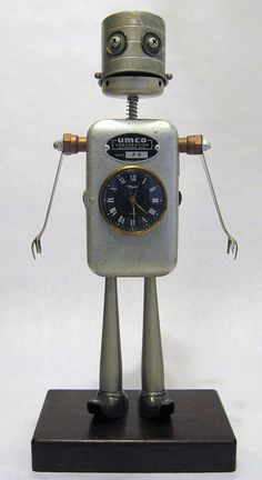 Umco is tall in his fancy little boots. The clock was working when I built him, I thought. Unfortunately, he loses an hour every twelve, or so. Ah well, so do I. Arte Robot, Diy Robot, Recycled Robot, Recycled Art, Repurposed, Steampunk Robots, Sculpture Metal, Retro Robot, Found Object Art