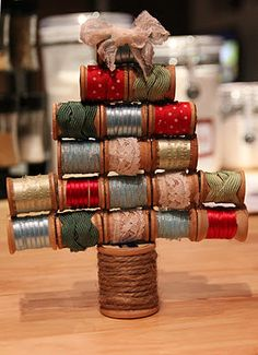 Vintage Spool Christmas Tree... add a button on the bow at the top of the tree
