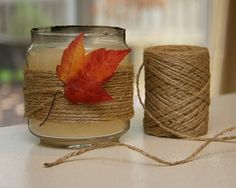 Cheap and way cute! I bought a 12 pack of candles(with their holders) at Michaels for 5 bucks! Get some twine(usually in the jewelry section) and a little glue.