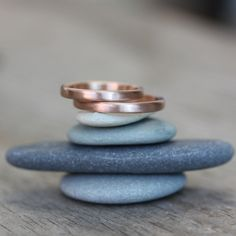 I usually hate wedding bands.. but I love the simplicity of these rings. Then again it could just be the great photography.