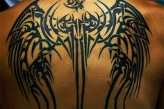 @Alicen Sue   Google Image Result for http://inkarttattoos.com/wp-content/uploads/2009/11/tribal-wing-back-tattoo.jpg