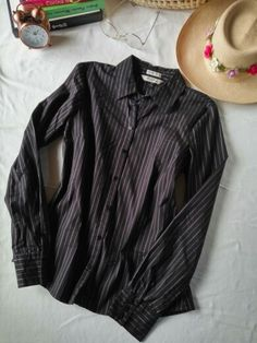 Old Navy. T. S. Camisera negra con rojo y blanco. Perfect fit, strech. $600. COBL0017