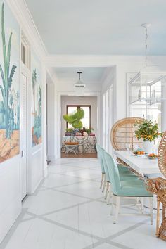 Island-Inspired Dining Room - Tour This Breezy South Carolina Beach House - Southernliving. Fortunately, this informal elegance is Keenan's stock in trade. She gave the interiors a Lowcountry-meets-British Colonial air, cross-pollinating a raft of family portraits and repurposed furnishings from the former home with a fresh collection of vintage and new pieces. And a tropical lightness prevails. Get the Look: Tropical de Gournay wall panels depicting an old island church elevate the sunny…