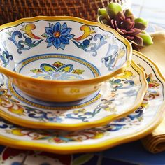 "Inspired by Italian art that dates back to the Renaissance, our shatter-resistant melamine plates will make your outdoor party feel like a Tuscan picnic. Alternating royal blue and yellow scrolls come full circle to give you a presentation that will have your dinner guests shouting, <i>""Bellissimo!""</i>"