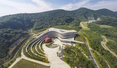 Fangshan Tangshan National Geopark Museum - Exterior:  Year of Construction: 2014 A building rises, contoured in a very organic way forging a relationship with it\'s site and the surrounding context.
