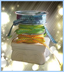 """Woven squares in beautiful color combinations. This 2 sided ribbon is 3/8"""" wide with 50 yards to the roll. These colors are difficult to find in combination. $33.95 per roll at www.favorsyoukeep.com - your source for unique ribbon. Use this ribbon for your scrapbooking, hair accessories, wedding favors or sewing projects.If you need any color assistance, please call the ribbon specialists at 512.323.0600. We love to chat about ribbon!"""