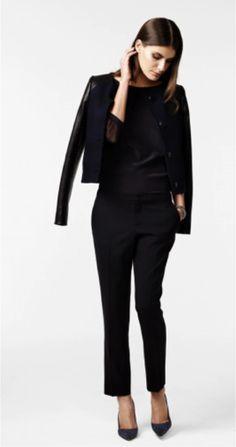 Women's slacks and leather/plaid jacket
