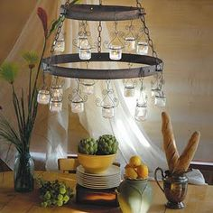 Ever wondered what to do with your empty baby food jars? This tea light chandelier might be exactly what you are looking for.