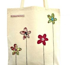 Sometimes a new bag can freshen up an outfit and now that it's #Spring why not treat yourself this #Easter to this cute shopping bag with pretty appliqued embroidered flowers.