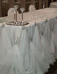 Thought this was a unique way to drape your head table linens by using brooches.  Image via weddingbee.com