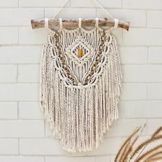 A soft and striking handmade wall hanging mounted onto treated driftwood. Made with natural cotton and jute cord with a mustard-coloured-bead feature.Ready for immediate shipping. Handmade Wall Hanging, Rope Basket, Macrame Patterns, Plant Hanger, Craft Stores, Jute, Weaving, Crafty, Beads