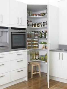 Good use of kitchen corner! Corner Pantry- like this idea for a kitchen remodel. Corner cupboard floor to ceiling instead of the wasted counter space in the middle we have now. Kitchen Corner Cupboard, Kitchen Redo, Kitchen Layout, New Kitchen, Kitchen Storage, Kitchen Ideas, Corner Storage, Kitchen Small, Pantry Ideas