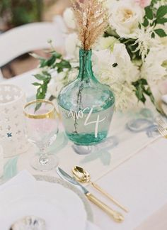7 Wedding Vase Centerpieces that Double as Table Numbers Wedding Vase Centerpieces, Bottle Centerpieces, Wedding Vases, Wedding Table Decorations, Wedding Table Numbers, Decoration Table, Wedding Reception, Boat Wedding, Centerpiece Flowers