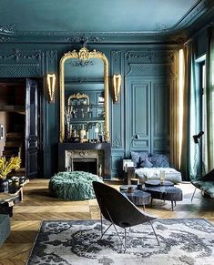 Parisian elegance... The rich teal walls are just next level dreamy! This blue interior is so regal and the architecture in this living room is exquisite!