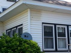 How to remove the yellow/orange stain from white vinyl siding. The Works toilet bowl cleaner, a sponge, and a hose. Apply cleaner to siding, wait a few minutes (do not let dry), rub with sponge and rinse off. Work in sections to keep from drying. Tried many things,  but only The Works did the job!!