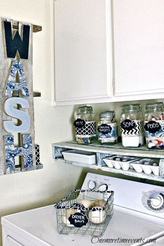 Laundry Room Makeover....letters covered in different colored jeans cut up