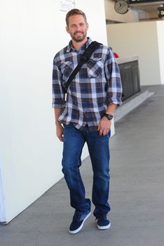 Paul Walker Photos Photos - Paul Walker is seen departing LAX Airport wearing a checked shirt and holding a bag across. - Paul Walker Leaves LA
