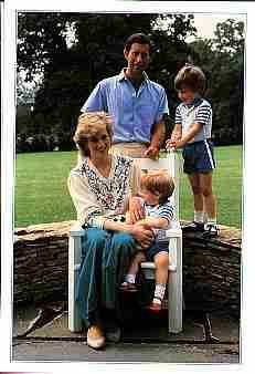 Princess DIANA, her son's William and Harry together with her husband princes Charles Phillip all having a quiet evening by the savannah sitting around chatting  with each other.