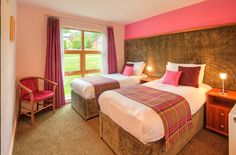 Twin Bedroom decorated in pink tartan at Loch Lomond Lodges Resort. This luxury bedroom has fabulous views of Loch Lomond.